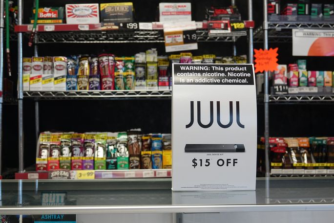 We B Smokin' in Columbia, Missouri posts multiple signs around their store about JUUL sales alongside warnings about the dangers of nicotine addictions Thursday, Sept. 13, 2018. Due to the popularity of the product, many stores have lowered the price of e-cigarattes, specifically Juul, from $19 to $15 despite mounting public outcry.