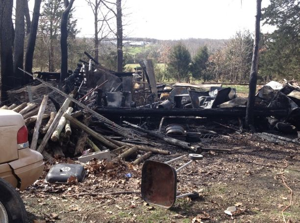 The remains of the cabin, burned down in the fire along with all the belongings inside.
