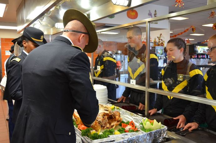 Tradition is that Fort Leonard Wood drill sergeants and senior leaders serve Thanksgiving meals to Soldiers in Training. (Photo credit: Dawn Arden, Public Affairs Office)