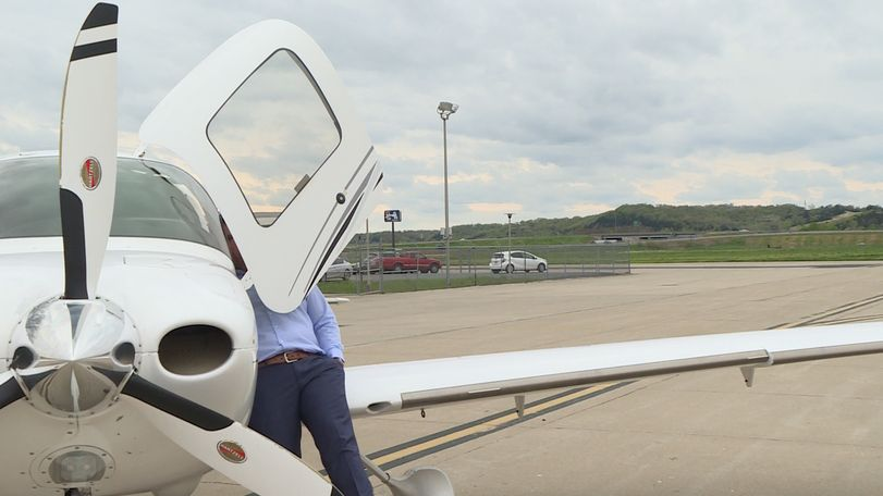 State Treasurer Scott Fitzpatrick looks into the cockpit of his plane at the Jefferson City Municipal Airport.