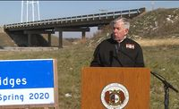Story image: Parson tours planned bridge site as MoDOT still faces funding challenges