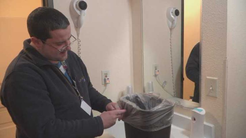 James White replaces the trash bag in one of the hotel rooms at Super 8 in Boonville. He's one of two Award of Excellence winners this year.