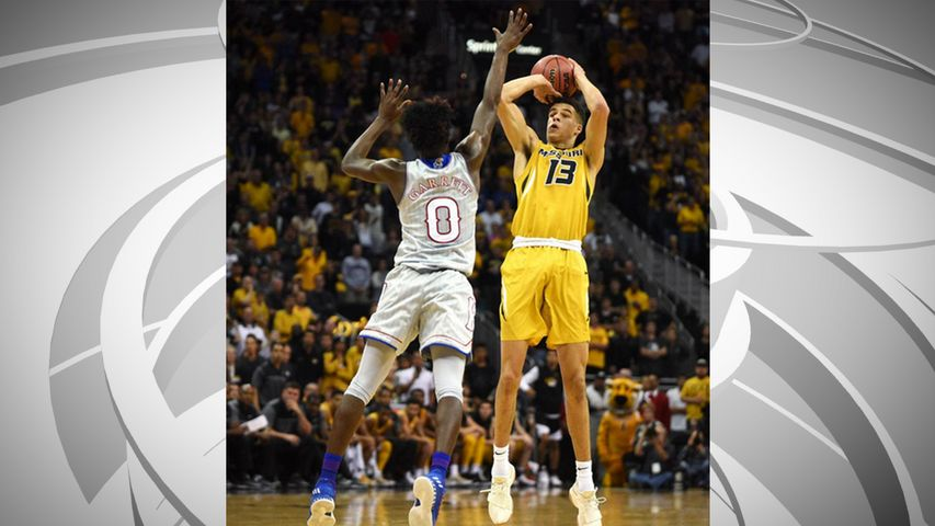 Missouri freshman Michael Porter Jr. rises up for a jump shot over Kansas defender Marcus Garrett during the first half of an Oct. 22, 2017, exhibition game against the Jayhawks at Sprint Center in Kansas City. Courtesy: Emil Lippe/Missourian