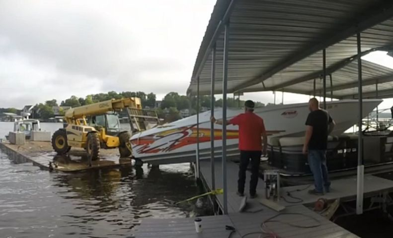 VIDEO: Crews remove boat lodged in roof of Lake of the
