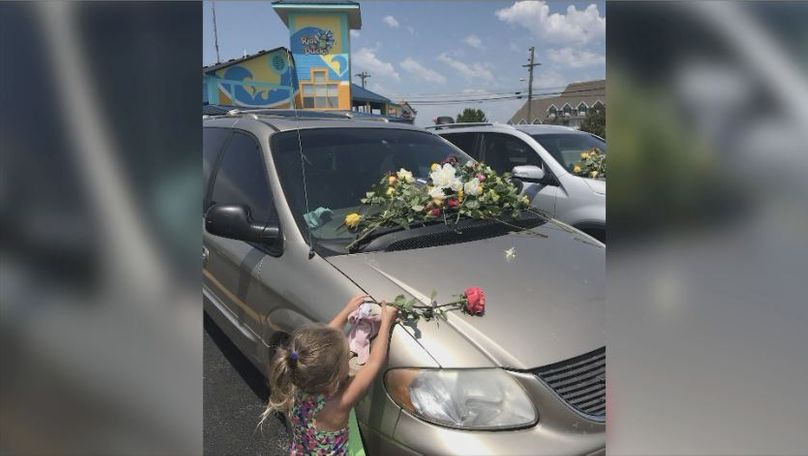 Reid and her children went to lay flowers on the cars left at the parking lot the day after the tragedy.