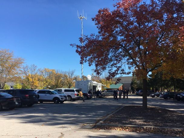 Police officers had a command center set up in the parking lot of Vivion Baseball Field, right across the street from Washington Park Ice Arena, on Monday, Oct. 29, 2018, in Jefferson City, Missouri.