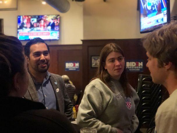 MannyAbarca, Kansas City Public School's Treasurer (left) at Joe Biden's watch party on Tuesday.
