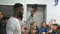 Story image: Gary Pinkel, L'Damian Washington give back to Douglass students