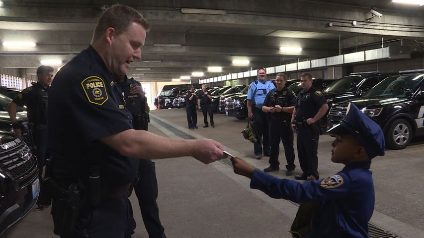 Chief Geoff Jones accepts a card from 8-year-old Adam Hassan.