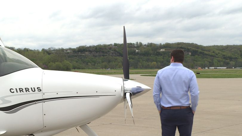 State Treasurer Scott Fitzpatrick walks toward the door of his plane.